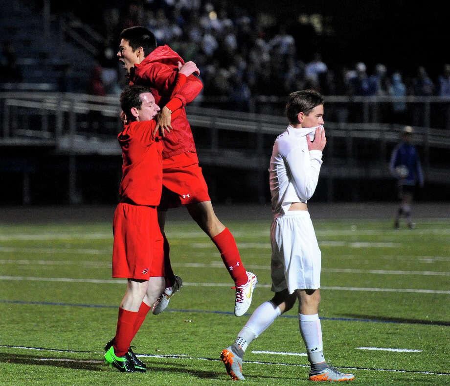 Greenwich players celebrate their win over Fairfield Ludlowe during the first round of Class LL boys soccer tournament Tuesday in Fairfield. Photo: Christian Abraham / Hearst Connecticut Media / Connecticut Post