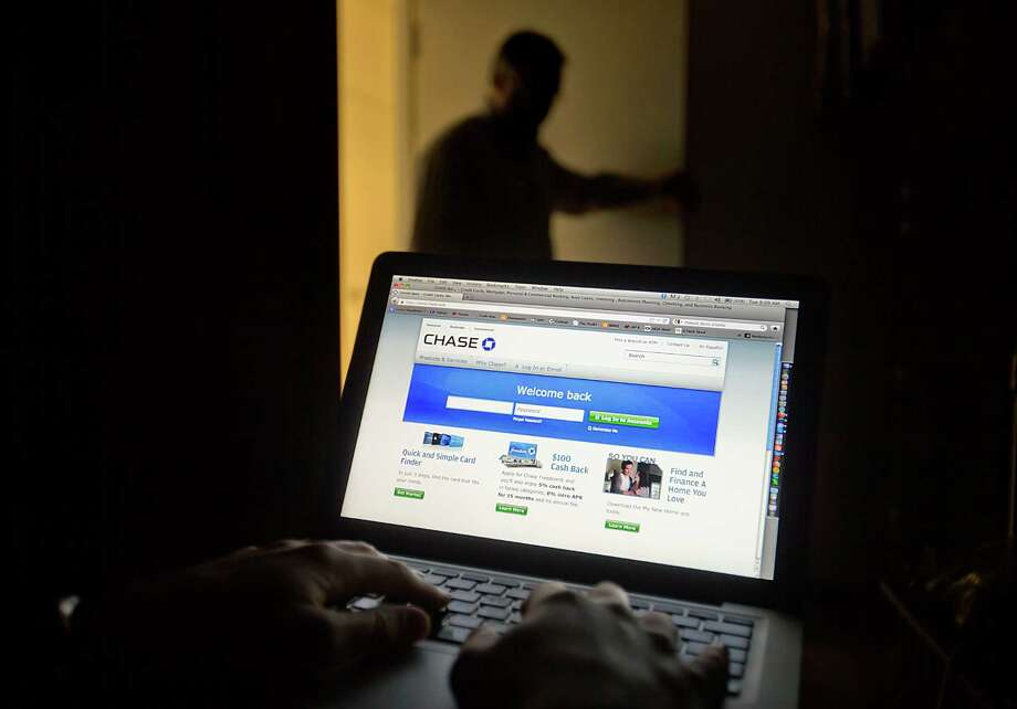 Some banks have shared financial data of customers from their websites with personal finance sites, but many have doubts. Photo: David Goldman, STF / AP