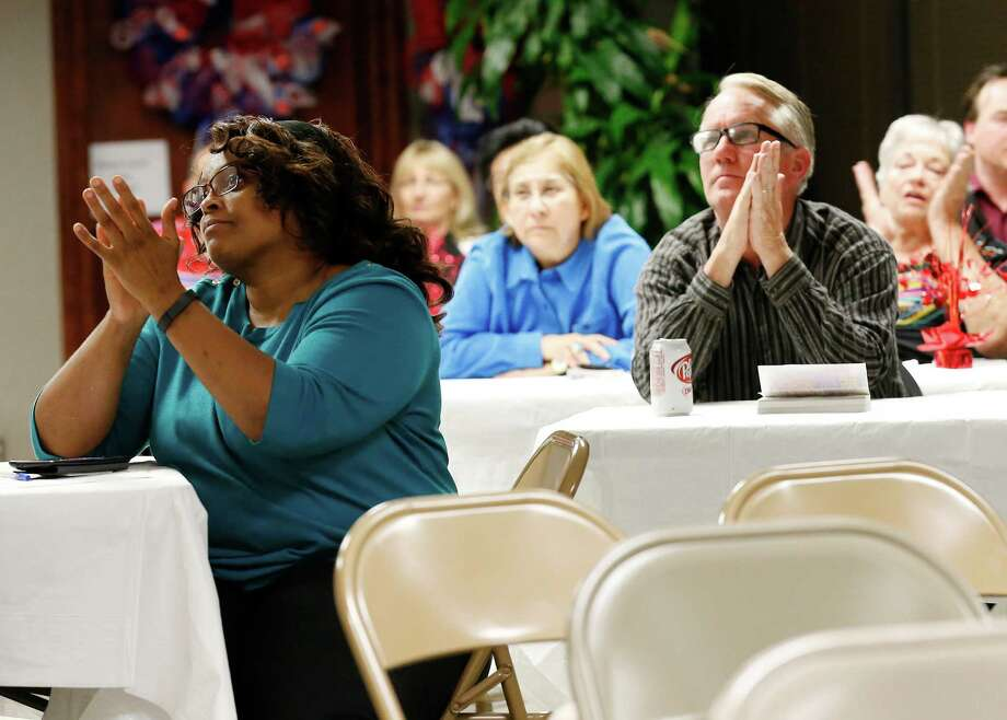 Pam Stevens (left) joins other GOP supporters at Bexar County GOP headquarters to watch the Republican Presidential debate on Tuesday, Nov. 10, 2015. (Kin Man Hui/San Antonio Express-News) Photo: Kin Man Hui, Staff / San Antonio Express-News / ©2015 San Antonio Express-News