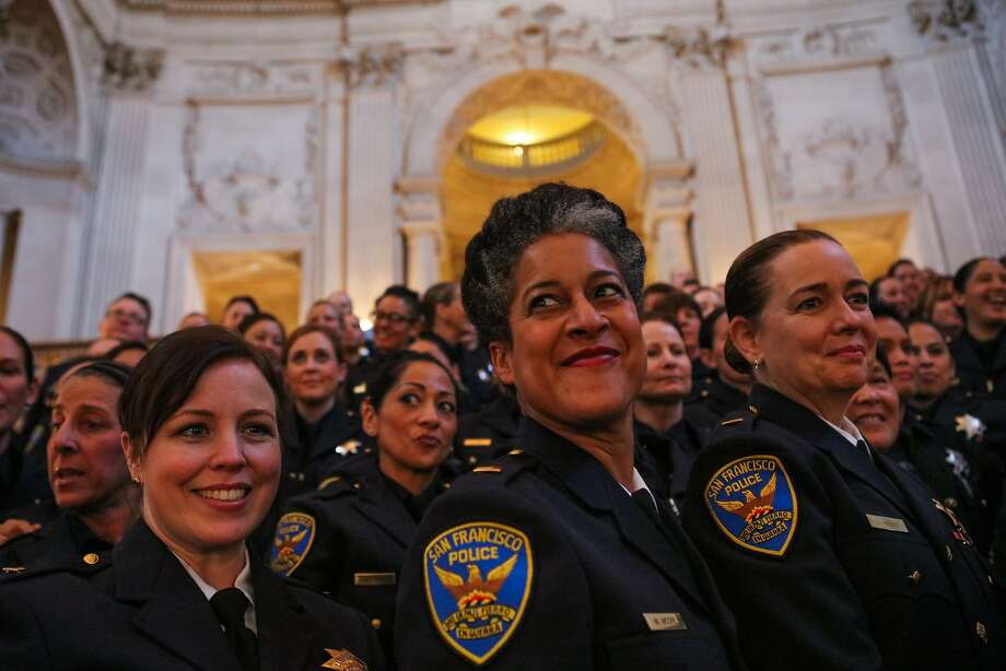Lt. Milanda Moore (center, red lipstick) posed with her fellow female police officers for a photo during the celebration of 40 years of women in patrol, at City Hall in San Francisco, California on Tuesday, November 10, 2015. Photo: Gabrielle Lurie, Special To The Chronicle