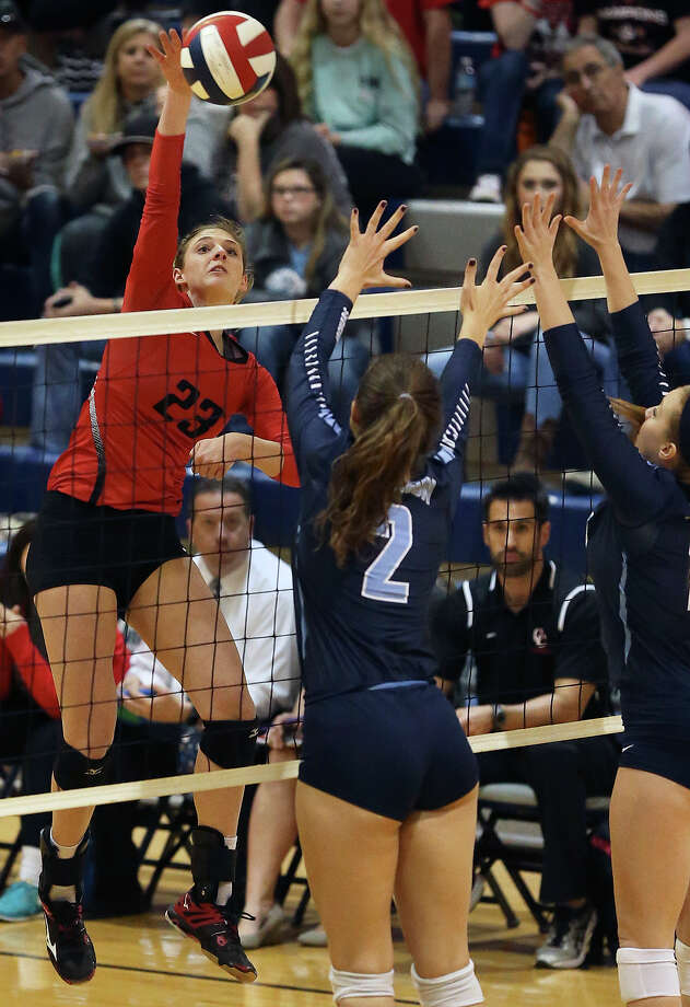 New Braunfels Canyon outside hitter KK Payne pounds a shot over the net during the Cougarettes' four-set victory over Johnson to advance to the 6A regional tournament. Photo: TOM REEL /SAN ANTONIO EXPRESS-NEWS / 2015 SAN ANTONIO EXPRESS-NEWS