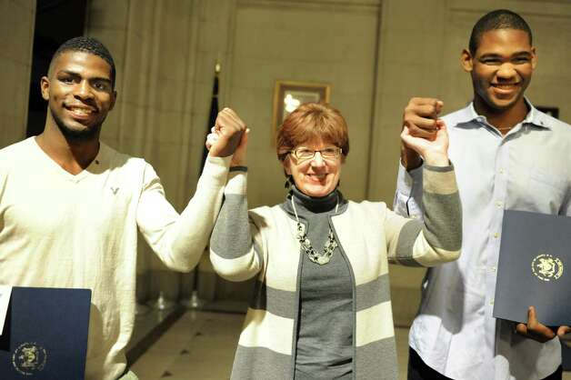 Mayor Kathy Sheehan, center, poses with local boxers Abraham Nova, 21, left, and Brandon Lynch, 24, who were honored on Tuesday, Nov. 10, 2015, at City Hall in Albany, N.Y. The two men will compete in the Olympic Boxing Trials in Reno, Nev. in December. (Cindy Schultz / Times Union) Photo: Cindy Schultz / 00034176A