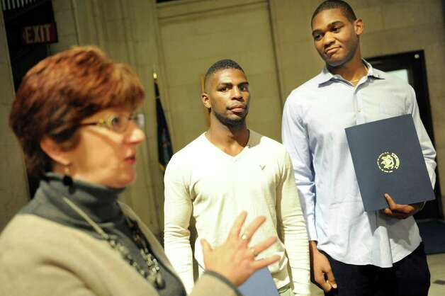 Mayor Kathy Sheehan, left, recognizes the accomplishments of local boxers Abraham Nova, 21, center, and Brandon Lynch, 24, on Tuesday, Nov. 10, 2015, at City Hall in Albany, N.Y. The two men will compete in the Olympic Boxing Trials in Reno, Nev. in December. (Cindy Schultz / Times Union) Photo: Cindy Schultz / 00034176A