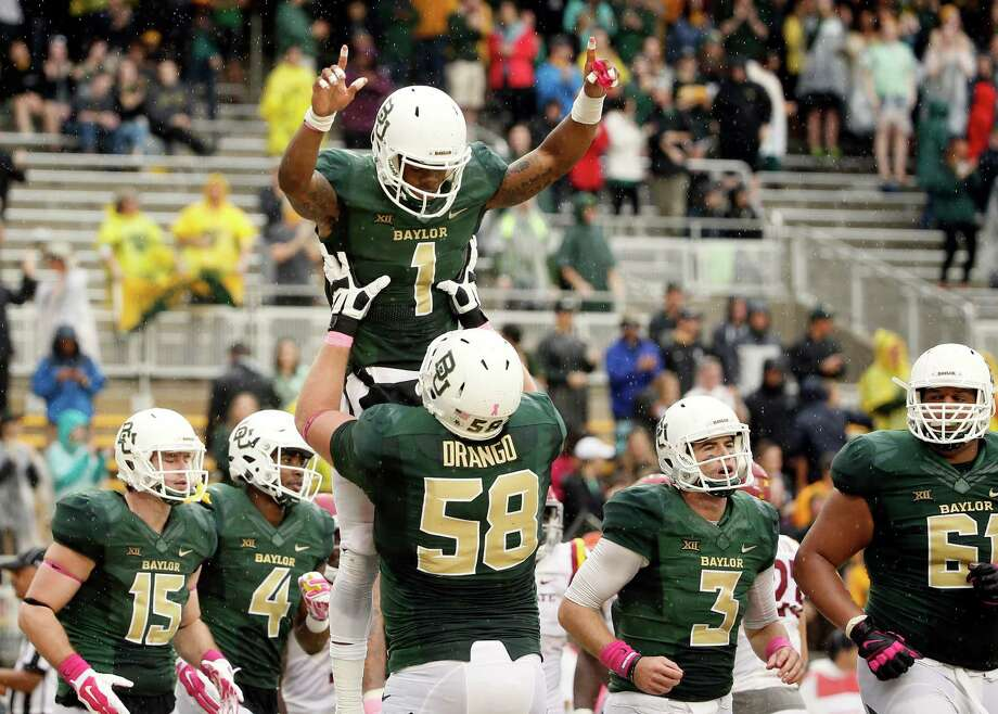 Baylor offensive tackle Spencer Drango (58) lifts wide receiver Corey Coleman (1) after Coleman caught a pass in the end zone for a touchdown in the second half of an NCAA college football game against Iowa State, Saturday, Oct. 24, 2015, in Waco, Texas. Baylor won 45-27. (AP Photo/Tony Gutierrez) Photo: Tony Gutierrez, STF / AP