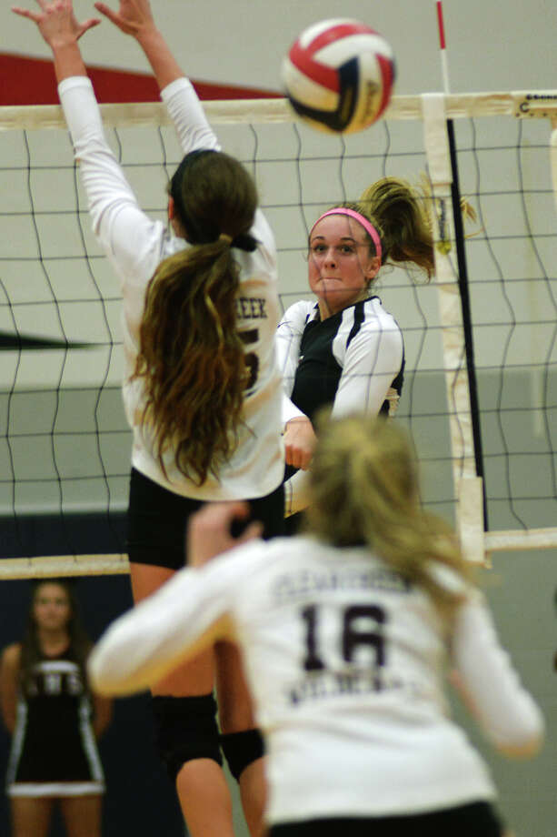 Fort Bend Austin's Dylan Brinkman, right, slams a spike past Clear Creek's Mariah Pardo. Photo: Jerry Baker, Freelance