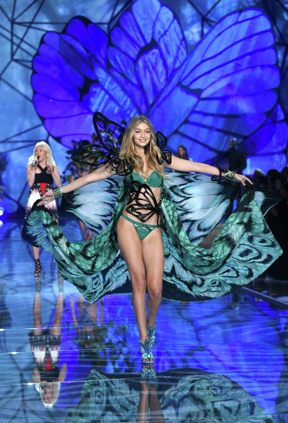 Gigi Hadid walks the runway as Ellie Goulding performs during the Victoria's Secret Fashion Show at the Lexington Armory on Tuesday, Nov. 10, 2015, in New York. The Victoria's Secret Fashion Show will air on CBS on Tuesday, Dec. 8, at 10pm EST. (Photo by Evan Agostini/Invision/AP)