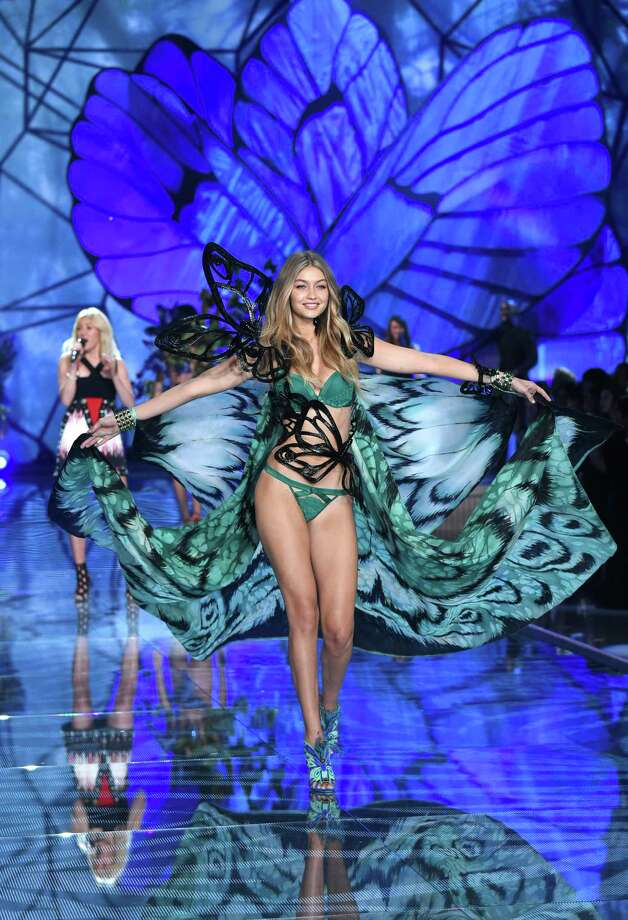 Gigi Hadid walks the runway as Ellie Goulding performs during the Victoria's Secret Fashion Show at the Lexington Armory on Tuesday, Nov. 10, 2015, in New York. The Victoria's Secret Fashion Show will air on CBS on Tuesday, Dec. 8, at 10pm EST. (Photo by Evan Agostini/Invision/AP) Photo: Evan Agostini, Evan Agostini/Invision/AP / Invision