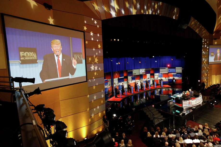 Donald Trump is seen on the screen as Republican presidential candidates John Kasich, Jeb Bush, Marco Rubio, Trump, Ben Carson, Ted Cruz, Carly Fiorina and Rand Paul appear during Republican presidential debate at Milwaukee Theatre, Tuesday, Nov. 10, 2015, in Milwaukee. (AP Photo/Morry Gash) Photo: Morry Gash, STF / AP