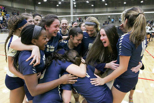 The O'Connor Lady Panthers celebrate their victory over Reagan in their UIL Class 6A third-round volleyball playoff match at Alamo Convocation Center on Nov. 10, 2015.