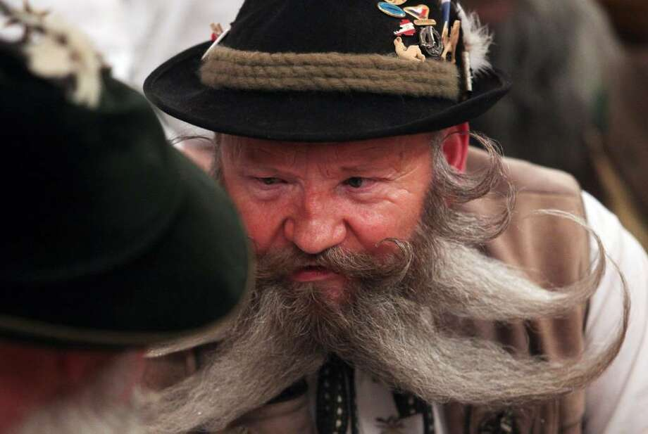 GARMISCH-PARTENKIRCHEN, GERMANY - MARCH 27:  Bearded men chat together during a local beard competition at Gasthof Werdenfelser Hof inn on March 27, 2010 in Garmisch-Partenkirchen, Germany. The event is part of the 25th Garmisch-Partenkirchen Beard Champioships. (Photo by Johannes Simon/Getty Images) Photo: Johannes Simon, Getty Images / 2010 Getty Images