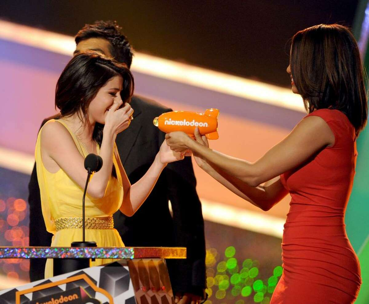 LOS ANGELES, CA - MARCH 27: Actress Selena Gomez accepts the Favorite TV Actress award from Tyra Banks onstage at Nickelodeon's 23rd Annual Kids' Choice Awards held at UCLA's Pauley Pavilion on March 27, 2010 in Los Angeles, California. (Photo by Kevin Winter/Getty Images for KCA) *** Local Caption *** Selena Gomez;Tyra Banks