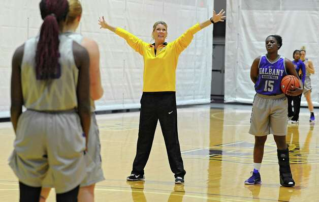 UAlbany women's basketball coach Katie Abrahamson-Henderson, center, works with her team during practice on Thursday, Oct. 15, 2015 at the SEFCU Arena in Albany, N.Y. (Lori Van Buren / Times Union) Photo: Lori Van Buren / 10033768A