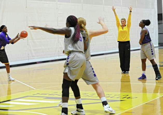 UAlbany women's basketball coach Katie Abrahamson-Henderson works with her team during practice on Thursday, Oct. 15, 2015 at the SEFCU Arena in Albany, N.Y. (Lori Van Buren / Times Union) Photo: Lori Van Buren / 10033768A