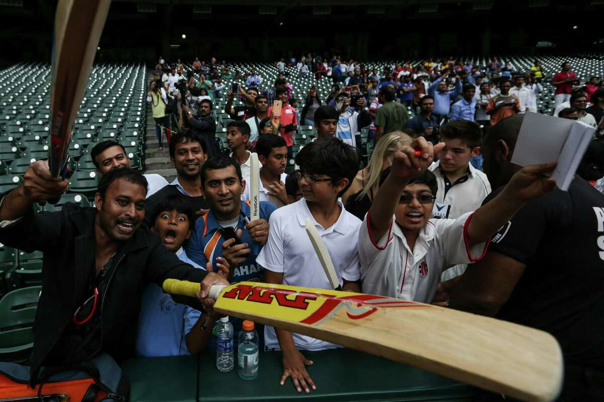 Fans cheer to get the attention and signatures from some of the most renowned cricket players from across the world at Minute Maid Park Tuesday, Nov. 10, 2015, in Houston. On Wednesday, cricket teams led by Sachin Tendulkar and Shane Warne will face off against each other in the the second Cricket All-Stars game at Minute Maid Park.