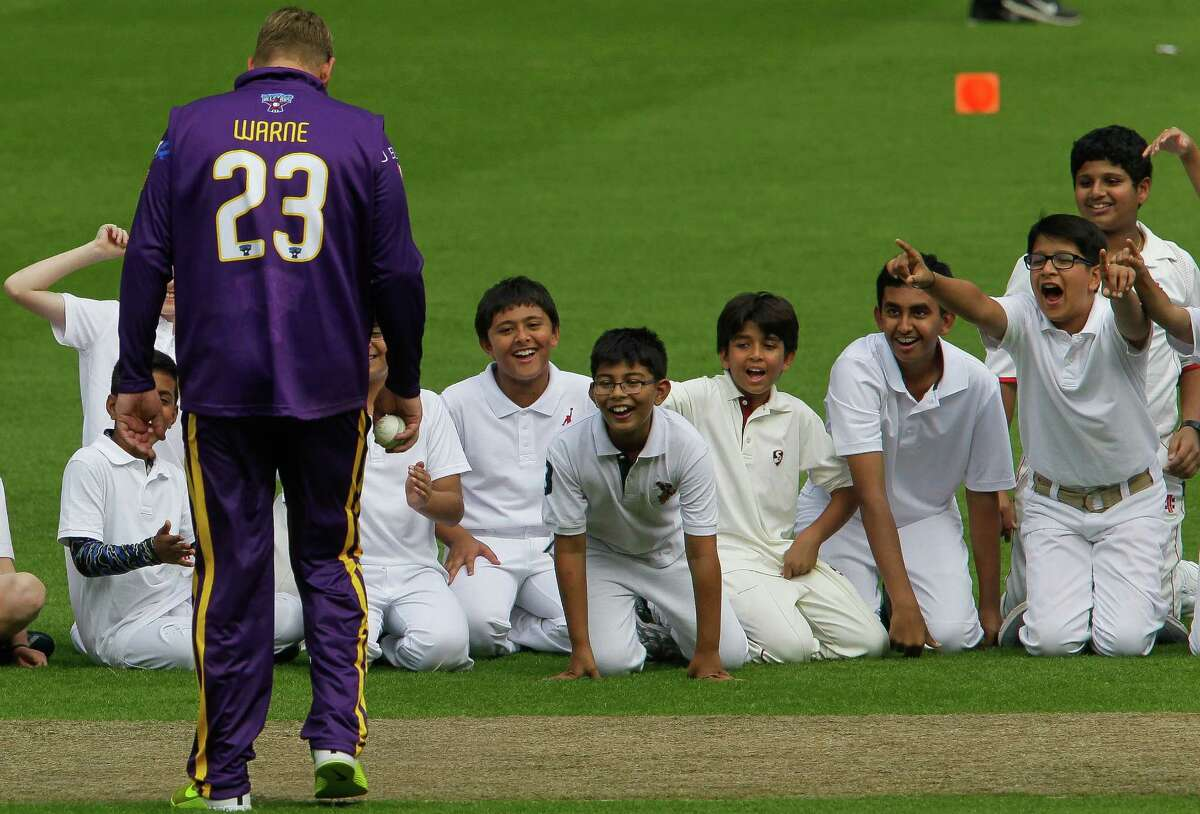 Kids from local cricket academies cheer as Cricket All-Stars team captain Shane Warne walks up to them at Minute Maid Park before teaching a clinic Tuesday, Nov. 10, 2015, in Houston. On Wednesday, cricket teams led by Warne and Sachin Tendulkar will face off against each other in the the second Cricket All-Stars game at Minute Maid Park.