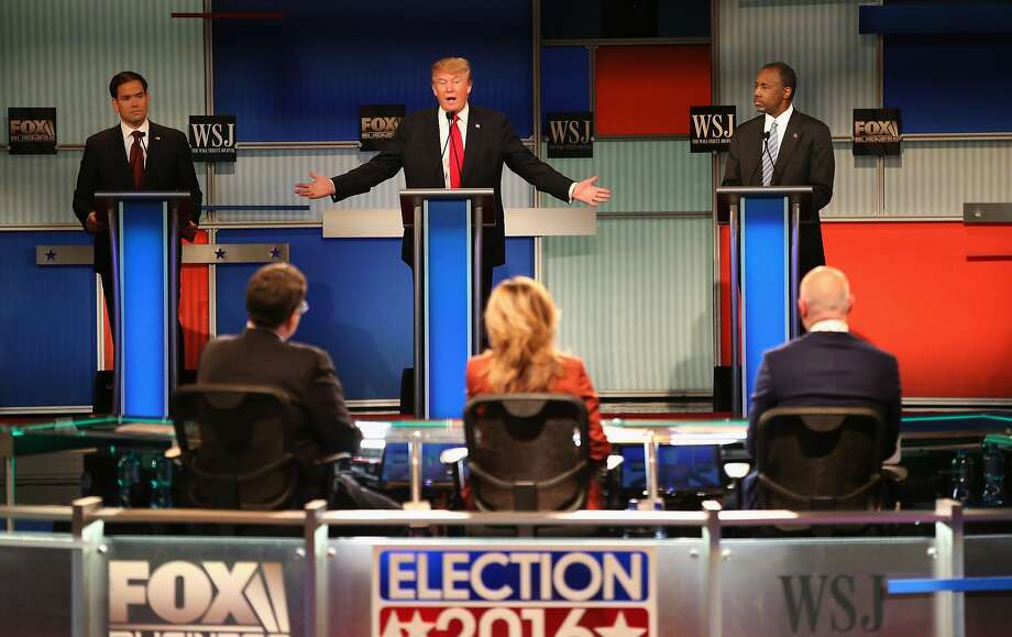 Donald Trump makes a point while Republican rivals Sen. Marco Rubio (left) and Dr. Ben Carson wait their turns. Moderators gave the candidates plenty of time to express themselves. Photo: Scott Olson, Getty Images