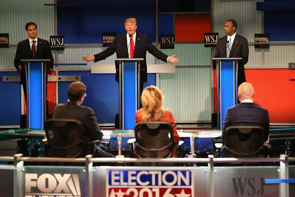 MILWAUKEE, WI - NOVEMBER 10:  Presidential candidate Donald Trump (C) speaks while Sen. Marco Rubio (L) (R-FL), and Ben Carson look on during the Republican Presidential Debate sponsored by Fox Business and the Wall Street Journal at the Milwaukee Theatre November 10, 2015 in Milwaukee, Wisconsin. The fourth Republican debate is held in two parts, one main debate for the top eight candidates, and another for four other candidates lower in the current polls.  (Photo by Scott Olson/Getty Images)