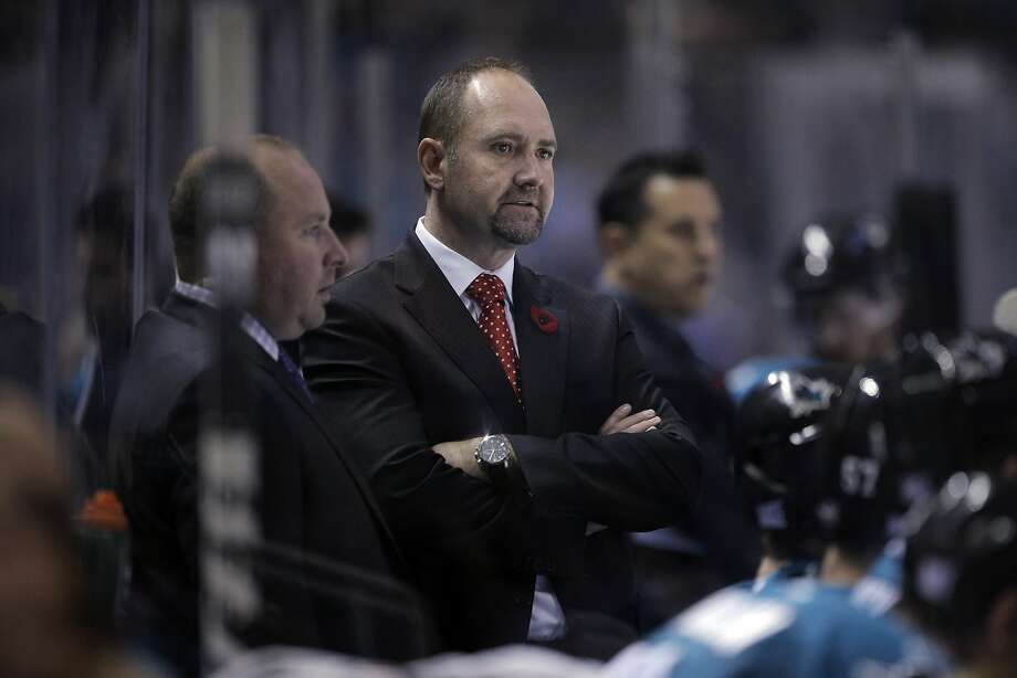 Sharks head coach Peter Deboer watches game action behind players on the bench during the Sharks game against the New York Islanders  at SAP Center in San Jose, Calif., on Tuesday, November 10, 2015. Deboer is in his first year as Sharks head coach. Photo: Carlos Avila Gonzalez, The Chronicle