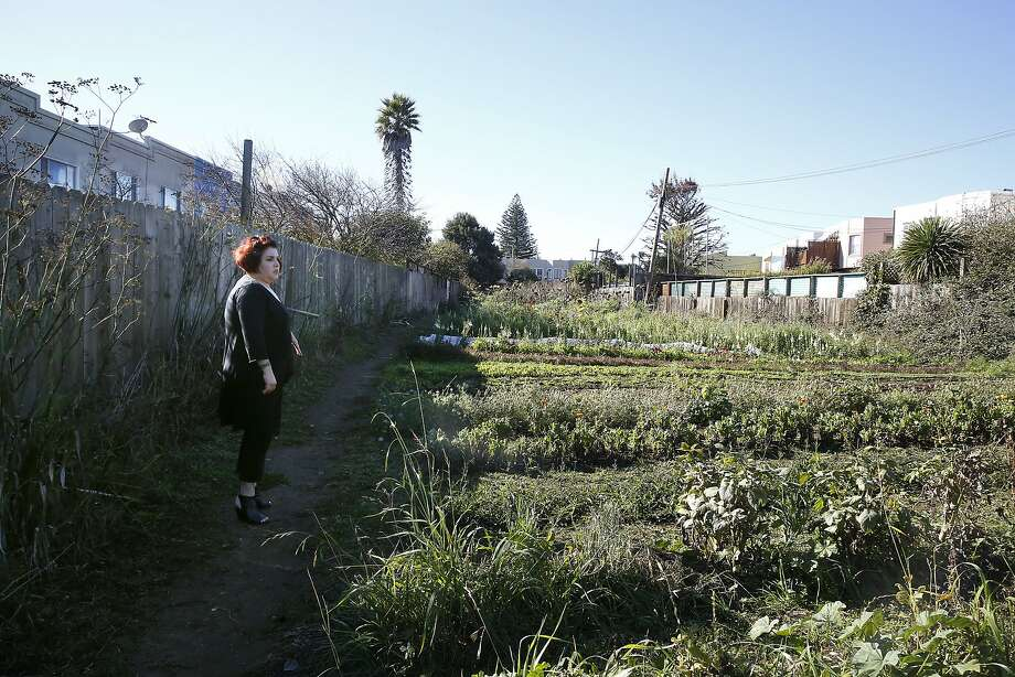 Neighbor Nancy Huff shows and talks about the Little City Farm site  in San Francisco, California, on Tuesday, November 10, 2015.  A private school, Golden Bridges School, is proposing to build it's campus on the three quarters of an acre site in the Excelsior. Photo: Liz Hafalia, The Chronicle