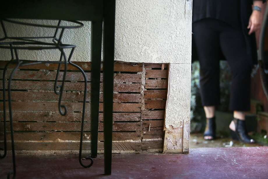 Nancy Huff shows water damage to her basement  in San Francisco, California, on Tuesday, November 10, 2015.   The Little City Farm site and homes in her neighborhood are prone to flooding during heavy rains. Photo: Liz Hafalia, The Chronicle