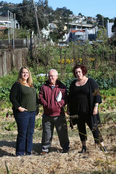 Neighbors Kerry Evensong (left), David Hooper (middle), and Nancy Huff (right) show and talk about the Little City Farm site in San Francisco, California, on Tuesday, November 10, 2015.  A private school, Golden Bridges School, is proposing to build it's campus on the farm in the Excelsior. Photo: Liz Hafalia, The Chronicle