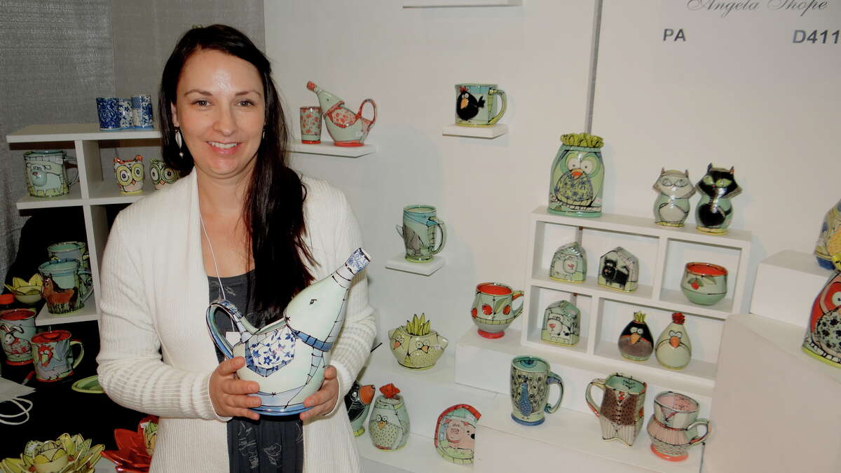 Ceramic Artist Angela Shope holds one of her elephant-shaped pitchers on the opening day of the Westport Young Woman's League's annual Craft Westport artisan shopping experience on Saturday, Nov. 7, 2015.