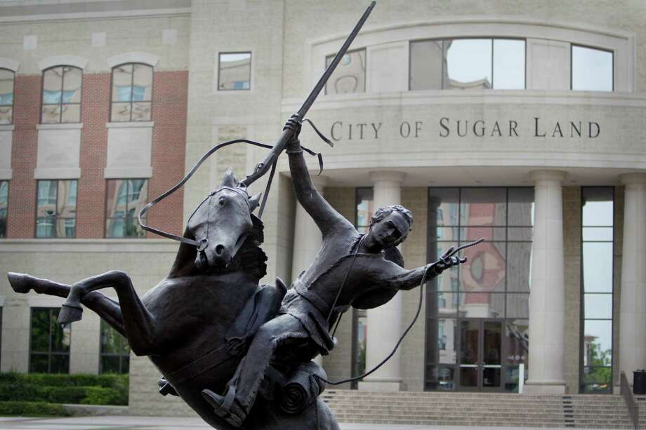 The city of Sugar Land is asking residents through an online survey to talk about what they like and would like to see regarding art in the community. One of the landmarks is a Stephen F. Austin sculpture by Bob Pack that is in the center of the plaza in the Sugar Land Town Square. Photo: Mayra Beltran, Staff / © 2014 Houston Chronicle