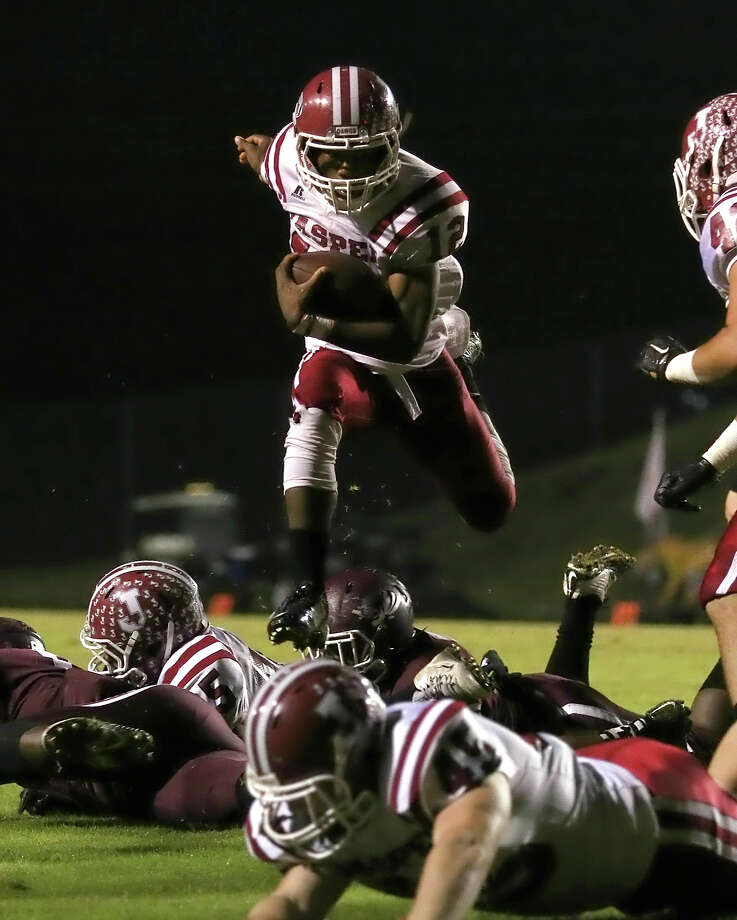 Tiger Williams leaps for a first quarter touchdown during the game between the Silsbee Tigers and the Jasper Bulldogs at Tiger Stadium in Silsbee, Friday night November 6th, 2015 - Photo provided by Kyle Ezell