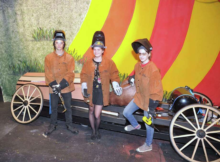 """The theater class at Cy Ranch High School has built a car for its production of """"Chitty Chitty Bang Bang."""" Makers of the """"magical car"""" include senior John Schmitt, left, and sophomores Piper Allien and MaKenna Leese, Photo: Eddy Matchette, Freelance / Freelance"""