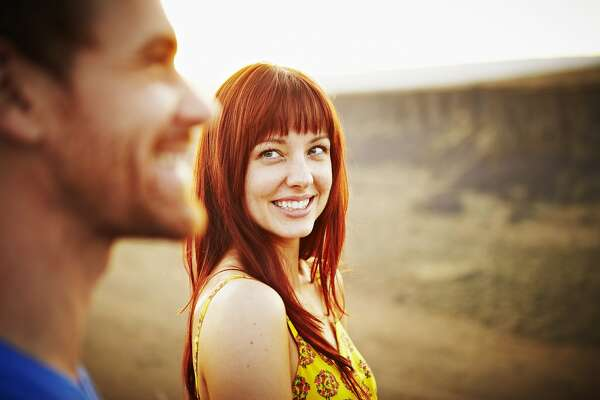 Woman smiling at boyfriend at sunset
