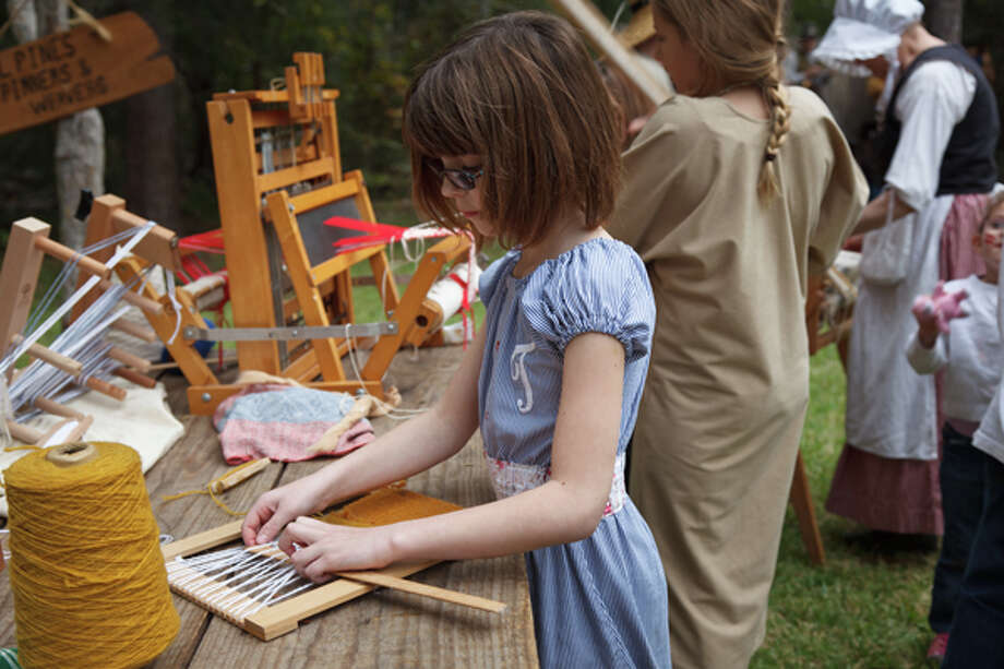 Get a taste of life in the 1820s at Jesse H. Jones Park & Nature Center as it hosts Pioneer Day. In addition to wagon rides and an Akokisa Indian Village,  the park will have authentically costumed historical re-enactors who will demonstrate settler-era cooking skills,  spinning and weaving, traditional music, black-powder weapons and blacksmithing. Photo: Courtesy Photo