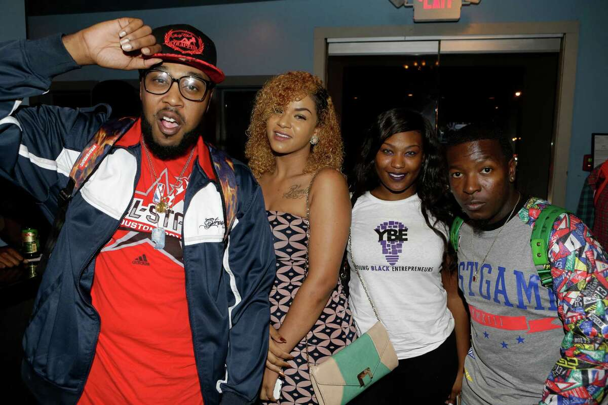 People pose for a photo during the listening event for rapper Pimp C's posthumous album Long Live The Pimp held at the Social Junkie, 2412 Washington Ave., Tuesday, Nov. 10, 2015, in Houston.