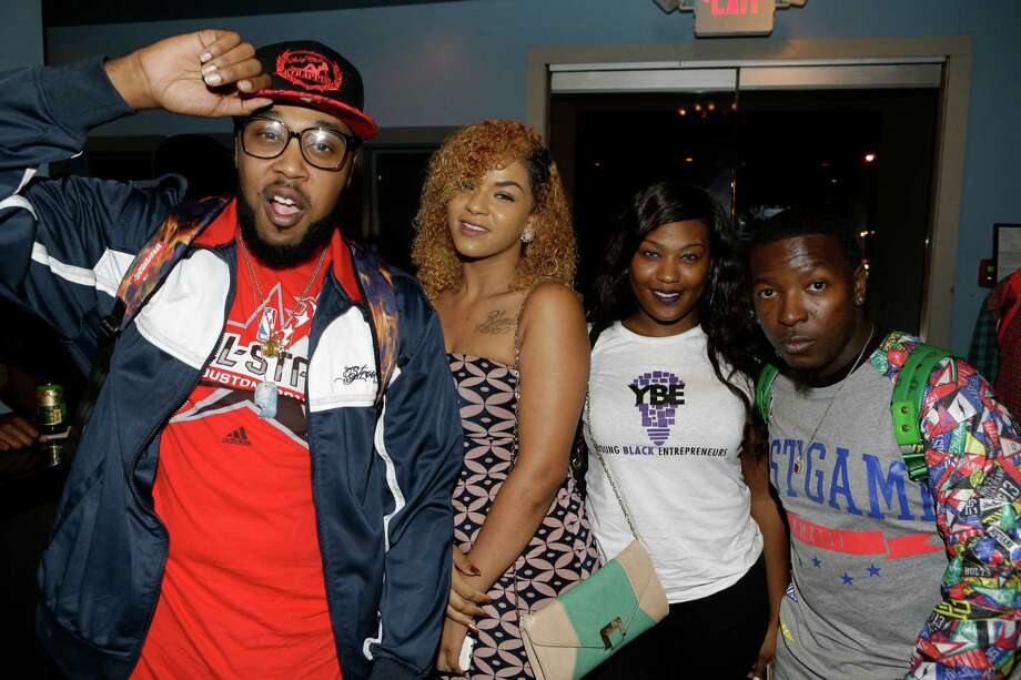 People pose for a photo during the listening event for rapper Pimp C's posthumous album Long Live The Pimp held at the Social Junkie, 2412 Washington Ave., Tuesday, Nov. 10, 2015, in Houston. Photo: Melissa Phillip, Houston Chronicle / © 2015 Houston Chronicle