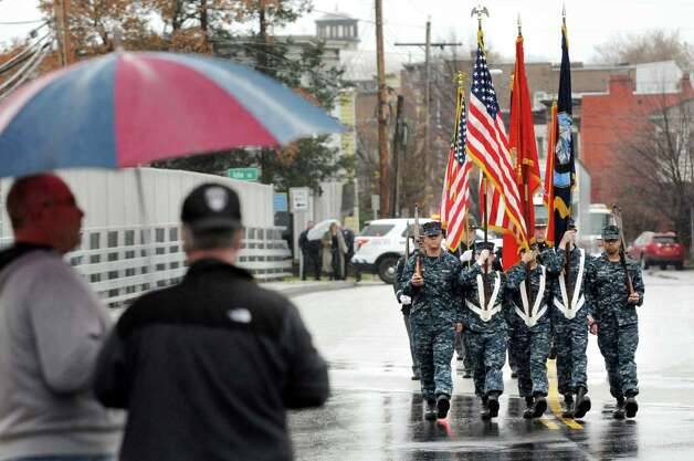 The U.S. Marine Corps. Reserve color guard crosses the span of the newly dedicated Pfc. Robert C. Felter Memorial Bridge on Veterans Day on Wednesday, Nov. 11, 2015, in Troy, N.Y. (Cindy Schultz / Times Union) Photo: Cindy Schultz / 00034128A