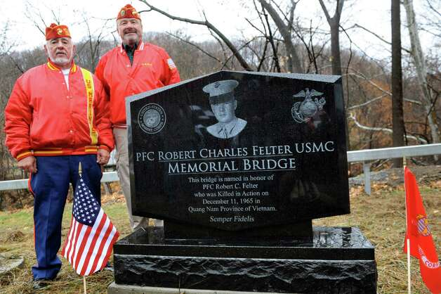 Veterans Lance Oliver, left, and Jack Mahar, both of the Troy detachment of the Marine Corps. League, pose alongside the monument honoring Pfc. Robert C. Felter, a fellow Marine who was killed in action during the Vietnam War, prior to the dedication of the Felter Memorial Bridge on Veterans Day on Wednesday, Nov. 11, 2015, in Troy, N.Y. (Cindy Schultz / Times Union) Photo: Cindy Schultz / 00034128A