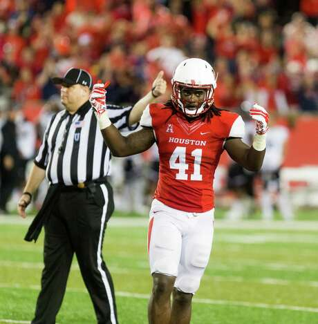 Houston's Steven Taylor (41) motions to the crowd to make some noise during the second half of an NCAA college football game at TDECU Stadium, Saturday, Nov. 7, 2015, in Houston. Houston defeated Cincinnati 33-30. (AP Photo/Juan DeLeon) Photo: Juan DeLeon, FRE / FR171058 AP