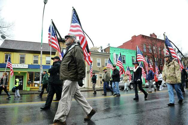 Members of the project, Operation: Please Remember Me, a group honoring veterans, march down Central Ave. as they take part in the 64th Annual Albany Veterans Day Parade on Wednesday, Nov. 11, 2015, in Albany, N.Y.  (Paul Buckowski / Times Union) Photo: PAUL BUCKOWSKI / 00034155A