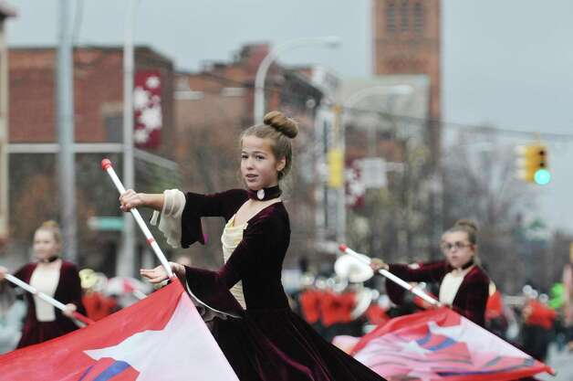 Members of the Mohonasen Marching Band, Rotterdam, perform as they march down Central Ave. during the 64th Annual Albany Veterans Day Parade on Wednesday, Nov. 11, 2015, in Albany, N.Y.  (Paul Buckowski / Times Union) Photo: PAUL BUCKOWSKI / 00034155A