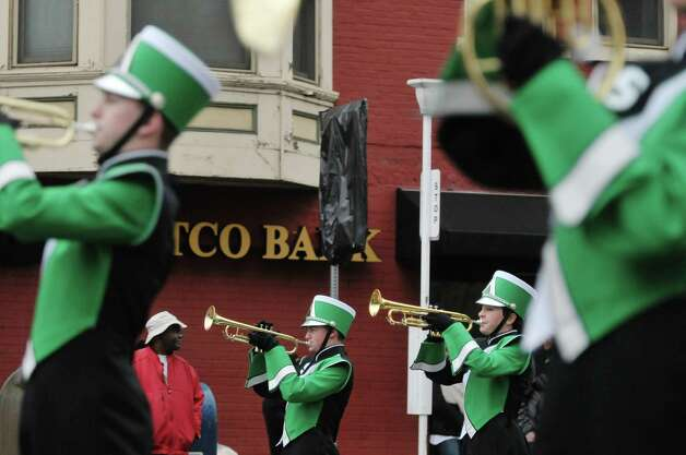 Members of the Schalmont Sabres Marching Band, Town of Rotterdam, perform a song as they take part in the 64th Annual Albany Veterans Day Parade on Wednesday, Nov. 11, 2015, in Albany, N.Y.  (Paul Buckowski / Times Union) Photo: PAUL BUCKOWSKI / 00034155A