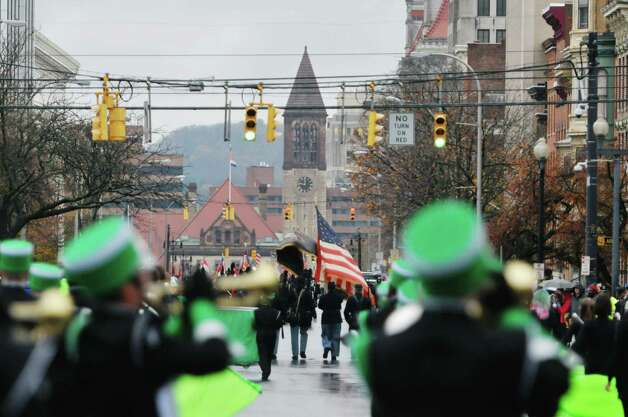 Participants in the 64th Annual Albany Veterans Day Parade march down Washington Ave. towards the reviewing stand  on Wednesday, Nov. 11, 2015, in Albany, N.Y.  (Paul Buckowski / Times Union) Photo: PAUL BUCKOWSKI / 00034155A