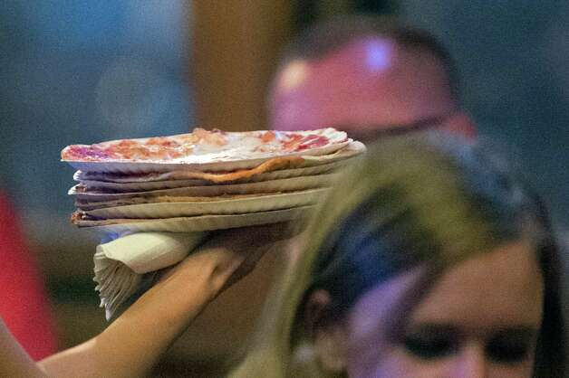 Small cheese pizzas arrive at a shared table on Thursday, Nov. 5, 2015, at City Beer Hall in Albany, N.Y. (Cindy Schultz / Times Union) Photo: Cindy Schultz / 00034106A