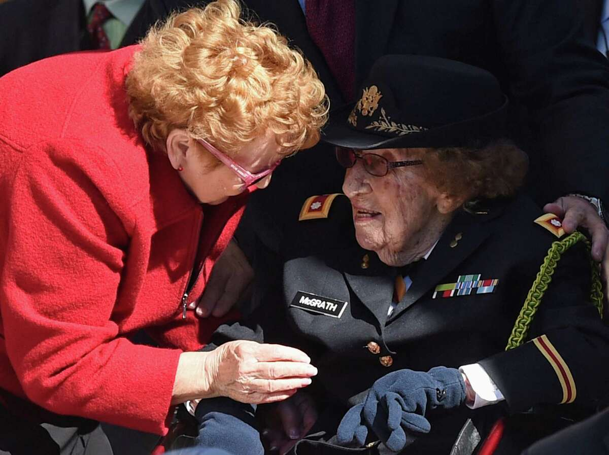 Army Lt. Col. Luta C. McGrath, 107, the oldest known female World War II veteran, right, is greeted as she is recognized by President Barack Obama during Veterans Day ceremonies, Wednesday, Nov. 11, 2015, at the Memorial Amphitheater of Arlington National Cemetery in Arlington, Va.