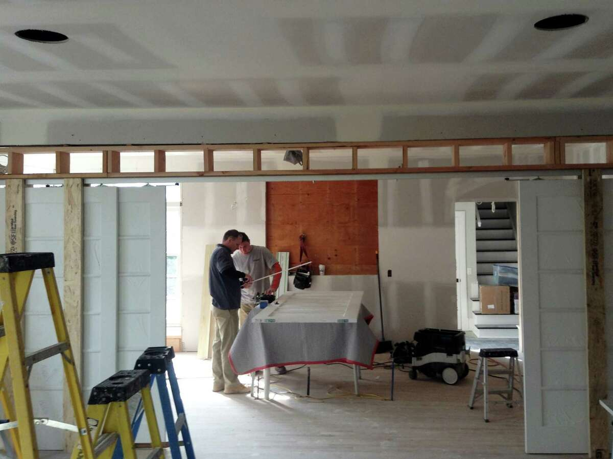 Workers remodeling a Greenwich home under general contractor DeRosa Construction in 2014. In the spring of 2016, Connecticut will formally adopt model building codes written by the International Code Council, with builders still getting up to speed on the changes in store.