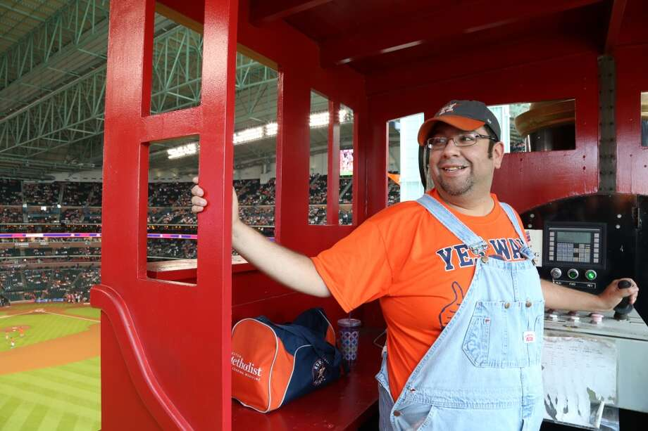 Bobby Vasquez, aka Bobby Dynamite, has the enviable job of conducting the train at Minute Maid Park. Every time the Astros get a home run, Vasquez moves the train down the track to the roar of the crowd,as seen on June 27, 2015. Photo: Houston Chronicle
