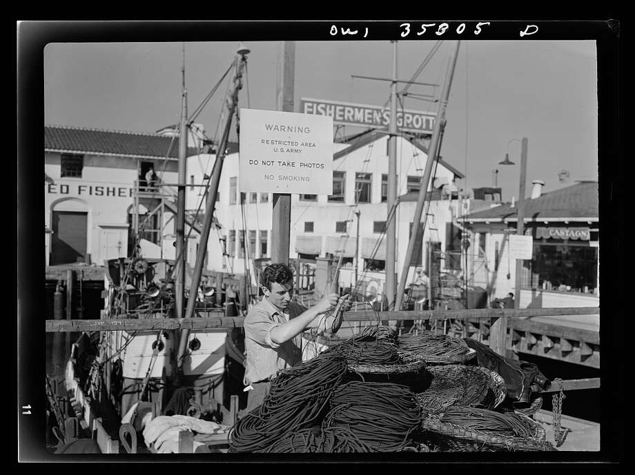 """Fisherman's Wharf in 1943. The white sign says """"Warning. Restricted Area U.S. Army. DO NOT TAKE PHOTOS."""" Photo: Ann Rosener, Library Of Congress"""