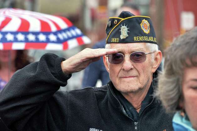 Dave Burgess of East Greenbush, a US Navy veteran salutes during the dedication of Veteran Crossing, the renaming of the Broadway Viaduct Bridge Wednesday, Nov. 11, 2015, in Rensselaer, N.Y.  (John Carl D'Annibale / Times Union) Photo: John Carl D'Annibale / 00034125A