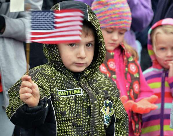 Four-year-old Shawn Bargy of Rensselaer waves a flag during the dedication of Veteran Crossing, the renaming of the Broadway Viaduct Bridge Wednesday, Nov. 11, 2015, in Rensselaer, N.Y.  (John Carl D'Annibale / Times Union) Photo: John Carl D'Annibale / 00034125A