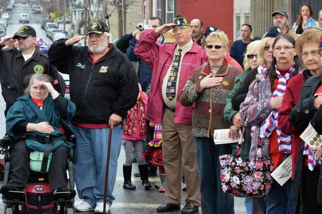 An enthusiastic crowd salutes during the dedication of Veteran Crossing, the renaming of the Broadway Viaduct Bridge Wednesday, Nov. 11, 2015, in Rensselaer, N.Y.  (John Carl D'Annibale / Times Union) Photo: John Carl D'Annibale / 00034125A