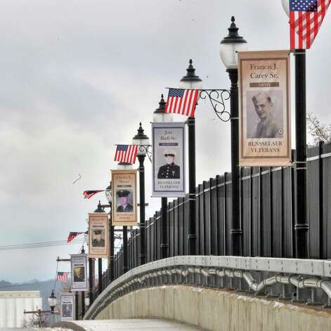 Banners honoring Rensselaer's veterans line the Broadway Viaduct Bridge renamed as Veteran Crossing during a Veteran's Day ceremony Wednesday, Nov. 11, 2015, in Rensselaer, N.Y.  (John Carl D'Annibale / Times Union) Photo: John Carl D'Annibale / 00034125A