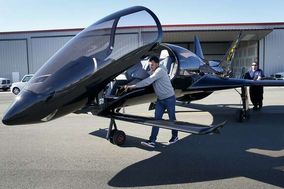David Loury (left), CEO of Cobalt Aircraft and designer of the Co50 Valkyrie airplane, pushes the plane onto the tarmac with Brandon Thompson at Hayward Executive Airport in Hayward, Calif. on Tuesday, Nov. 10, 2015, ahead of its debut on Thursday.